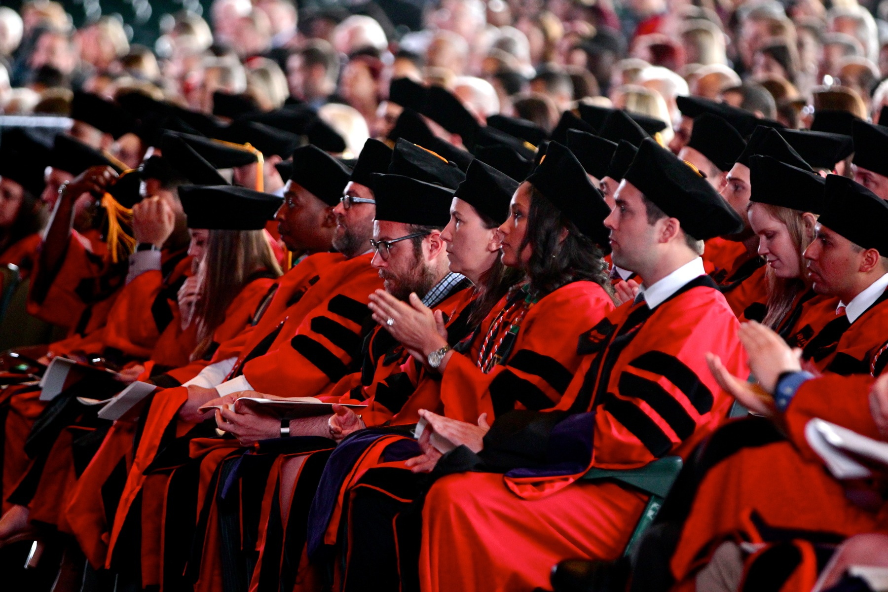 Rutgers Camden law degree candidates applaud keynote speaker Anita Hill curing a commencement ceremony at BB&T Pavillion in Camden.