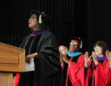 Keynote speaker Anita Hill receives a standing ovation at Rutgers Camden law school graduation. She also received an honorary doctor of law degree.