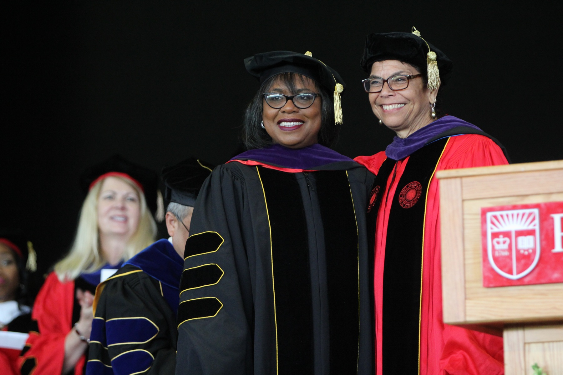 Anita Hill (center) receives an honorary doctor of laws degree from Rutgers Law School Chancellor Phoebe Haddon during a commencement ceremony in Camden.