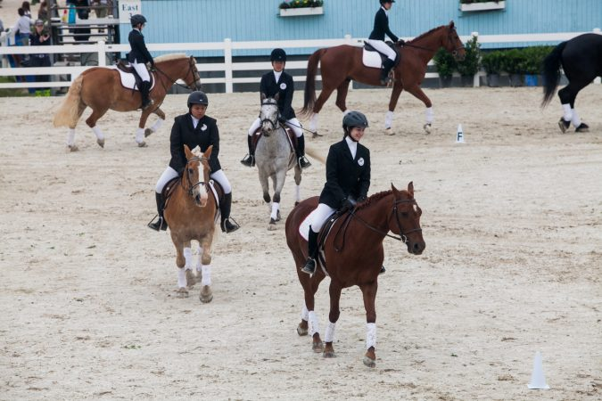 Competitors in the Therapeutic Riders Division ride in different formations at the Devon Horse Show. (Brad Larrison for WHYY)