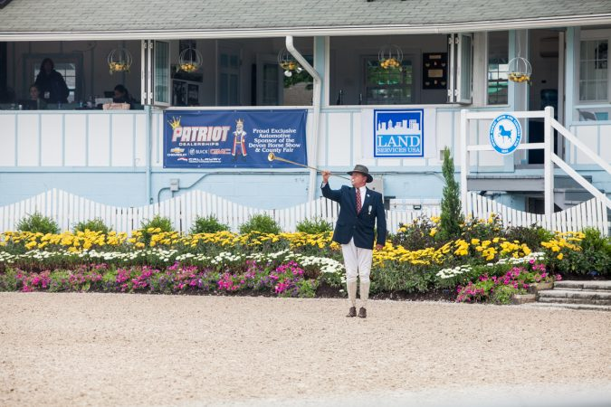 A bugler sounds off to start another round of equestrian competition at the Devon Horse Show. (Brad Larrison for WHYY)