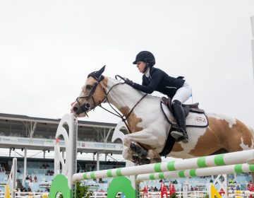 Holly Koczon jumps her horse Angel at the 122nd annual Devon Horse Show Sunday, May 27. (Brad Larrison for WHYY)