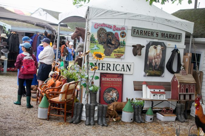 Vendors sell antiques and other goods at the country fair portion of the Devon Horse Show on Sunday, May 27. (Brad Larrison for WHYY)
