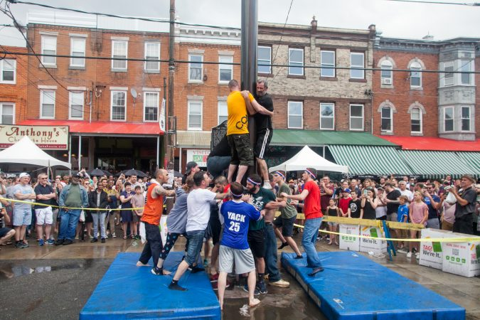 After the weather cleared the South Philly team made another attempt to climb the grease pole. (Brad Larrison for WHYY)