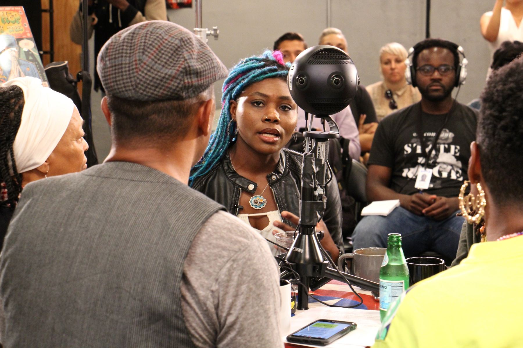 Amalgam Comics owner Ariell Johnson (center) participates in a roundtable discussion with other black coffeeshop owners focusing on how to boost black businesses and combat racism.