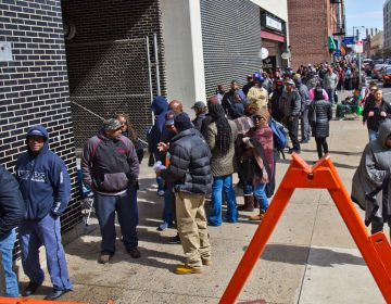 People line up around the block to pay their tickets on the final day of amnesty offered by the Philadelphia Parking Authority. Those still in line at the close of business were offered rainchecks (Kimberly Paynter/WHYY)