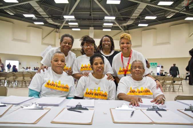 Members of the Enon Tabernacle Baptist Church volunteer to assist people with bench warrants and parole violations at the Philadelphia Safe Return event. (Kimberly Paynter/WHYY)