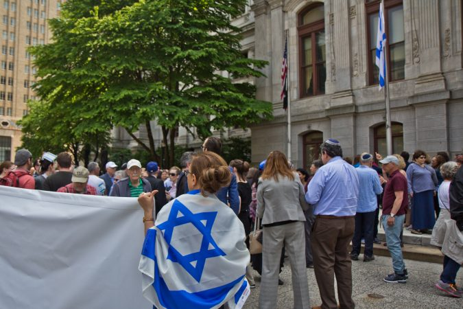 The flag of Israel is raised above City Hall in Philadelphia Monday. (Kimberly Paynter/WHYY)