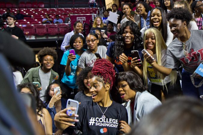 Actress Keke Palmer takes a selfie with college-bound seniors from Girls High School. (Kimberly Paynter/WHYY)