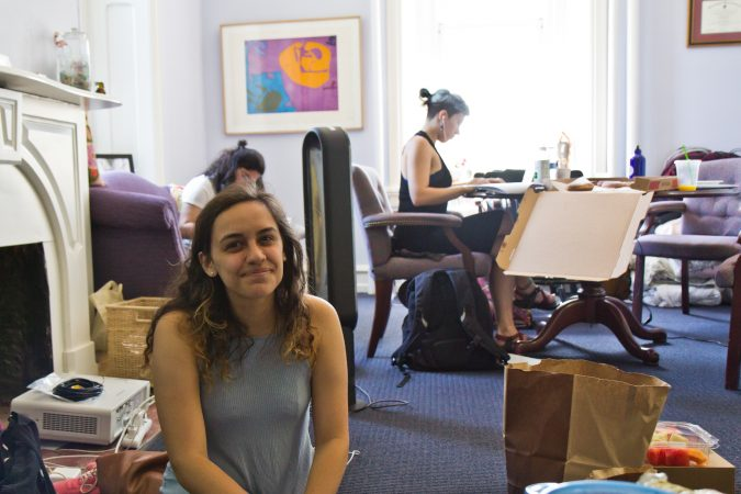 Swarthmore student Morgin Goldberg sits in the office of Liz Braun, dean of students, to protest the school's handling of sexual assault allegations. (Kimberly Paynter/WHYY)