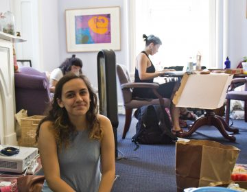 Swarthmore student Morgin Goldberg sits in the office of Liz Braun, dean of students, in protest of the college's response to sexual assault allegations. (Kimberly Paynter/WHYY)