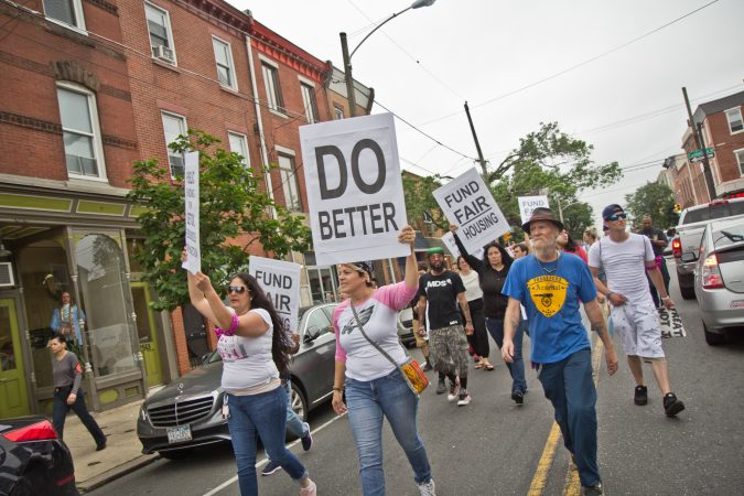 Protesters march down Frankford Avenue on the border of the Fishtown and Kensington sections of Philadelphia an hour before the city began removing people and their belongings from encampments in Kensington. (Kimberly Paynter/WHYY)