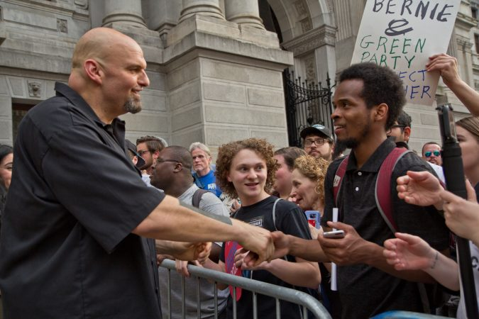 John Fetterman, Democratic primary candidate for lieutenant governor of Pennsylvania, speaks to supporters at City Hall in Philadelphia Friday evening. (Kimberly Paynter/WHYY)
