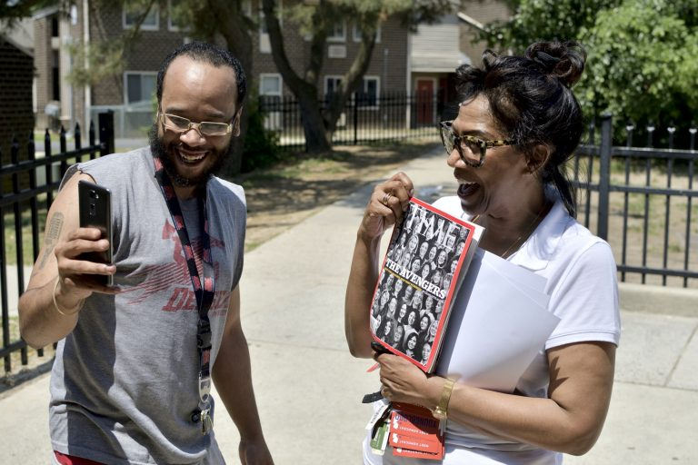 Congressional candidate Tanzie Youngblood holds up a Time magazine with her photo on the cover as Will Brant uses his phone to record a Snapchat story. Youngblood was campaigning at a low-income housing project in Bridgeton, New Jersey, on May 26, 2018.