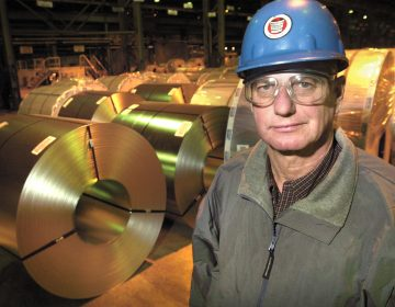 In this file photo, former Independent Steelworkers Union President, Walter Bish, of Weirton, W.Va., and a retired steelworker stands near steel coils located at Weirton Steel plant in Weirton, Thursday, Jan. 8, 2004.  In 1984, Weirton Steel Corp. created a labor legacy, becoming the first major manufacturer and the largest company in America to be owned 100 percent by employees. Its early success inspired United Airlines, Avis and Polaroid, among others, to adopt Employee Stock Ownership Plans. Today, Wawa participates in the little-known program.  (Scott McCloskey/AP Photo)