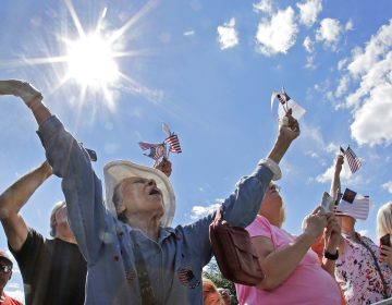 Ernestine Cuellar raises her hands in prayer during a rally on Boston Common in 2016. (Elise Amendola/AP Photo)