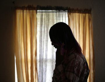 In this Monday, Dec. 5, 2016 photo, a 19-year-old transgender teen, who declined to be identified because she feared for her life after receiving death threats this summer at a halfway house, poses for a photo. (Eric Gay/AP Photo)