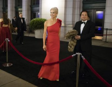 In this Thursday, Jan. 19, 2017 file photo, President-elect Donald Trump adviser Kellyanne Conway, accompanied by her husband, George, speaks with members of the media as they arrive for a dinner at Union Station in Washington, the day before Trump's inauguration. (Matt Rourke/AP Photo)