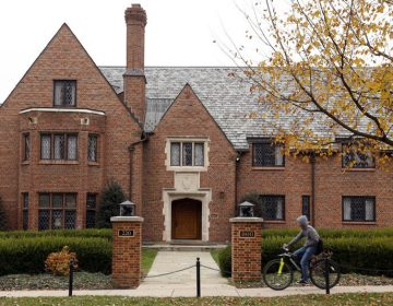 A bicyclist rides past Pennsylvania State University's shuttered Beta Theta Pi fraternity house Thursday, Nov. 9, 2017, in State College, Pa. Centre County, Pa., District Attorney Stacy Parks Miller announced Monday, Nov. 13, 2017, that more charges have been filed against fraternity brothers after investigators recovered deleted surveillance video footage recorded before the Feb. 4, 2017, death of 19-year-old Tim Piazza, of Lebanon, N.J., after a night of heavy drinking. (AP Photo/Gene J. Puskar)