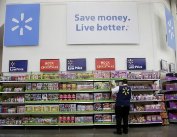 In this Thursday, Nov. 9, 2017, photo, Walmart employee Kenneth White scans items while conducting an exercise during a Walmart Academy class session at the store in North Bergen, N.J. (Julio Cortez/AP Photo)