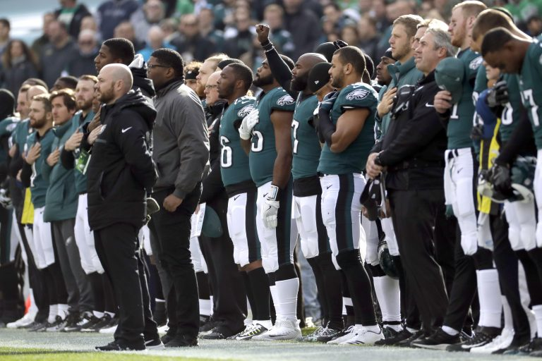 Philadelphia Eagles' Malcolm Jenkins, (center), gestures during the national anthem before an NFL football game against the Chicago Bears, Sunday, Nov. 26, 2017, in Philadelphia.