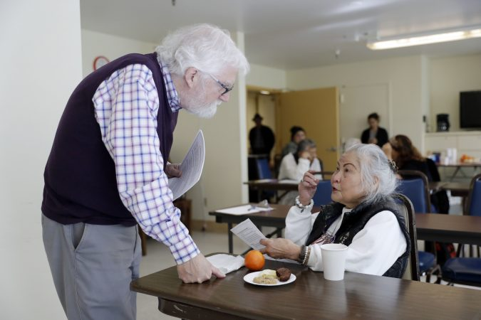 In this Friday, April 13, 2018 photo, Patrick Arbore, (left), talks to Corazon Leano as he conducts an anti-bullying class at the On Lok 30th Street Senior Center in San Francisco. Nursing homes, senior centers and other places older adults gather are confronting a problem long thought the domain of the young: Bullying. (Marcio Jose Sanchez/AP Photo)