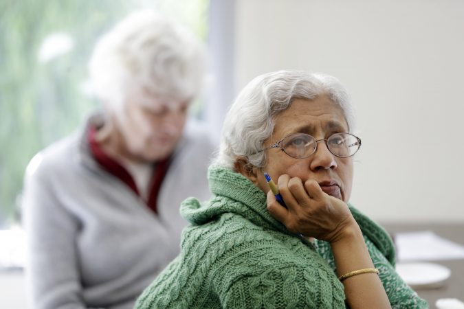 In this Friday, April 13, 2018 photo, Sara Dhamija, (right), listens to a teacher during an anti-bullying class at the On Lok 30th Street Senior Center in San Francisco. Nursing homes, senior centers and housing complexes for the elderly have introduced programs, training and policies aimed at curbing spates of bullying, an issue once thought the exclusive domain of the young. (Marcio Jose Sanchez/AP Photo)