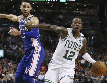 Boston Celtics guard Terry Rozier (12) dribbles by Philadelphia 76ers guard Ben Simmons in the second half of Game 2 of an NBA basketball second-round playoff series, Thursday, May 3, 2018, in Boston. The Celtics won 108-103. (AP Photo/Elise Amendola)
