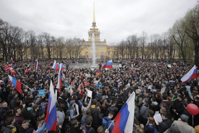 Protesters attend a rally in St. Petersburg, Russia, Saturday, May 5, 2018. Alexei Navalny, anti-corruption campaigner and Putin's most prominent critic, called for nationwide protests on Saturday, two days ahead of the inauguration of Vladimir Putin for a fourth term as Russian president. (Dmitri Lovetsky/AP Photo)