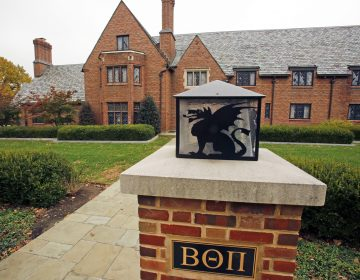 FILE – This Nov. 9, 2017, file photo shows Pennsylvania State University's shuttered Beta Theta Pi fraternity house in State College, Pa. Centre County, Pa.,(AP Photo/Gene J. Puskar, File)
