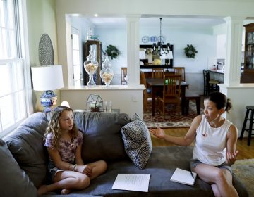 In this Thursday, May 3, 2018 photo, Sandy Nissenbaum, (right), and her daughter, Nora Nissenbaum, 12, talk during an interview with The Associated Press in Wayne, Pa. The case of a suburban Philadelphia boy who was quietly allowed to return to class after being accused of making a shooting threat has thrown a spotlight on the hard decisions school authorities must make. Nora Nissenbaum who says the boy bullied her has withdrawn from class for fear of him. (Matt Slocum/AP Photo)