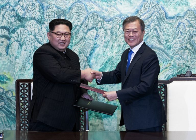 In this April 27, 2018 file photo, North Korean leader Kim Jong Un, (left), and South Korean President Moon Jae-in shake hands after signing on a joint statement at the border village of Panmunjom in the Demilitarized Zone, South Korea. The two Koreas will hold a high-level meeting on Wednesday, May 16, 2018, to discuss setting up military and Red Cross talks aimed at reducing border tension and restarting reunions between families separated by the Korean War. (Korea Summit Press Pool via AP, File)
