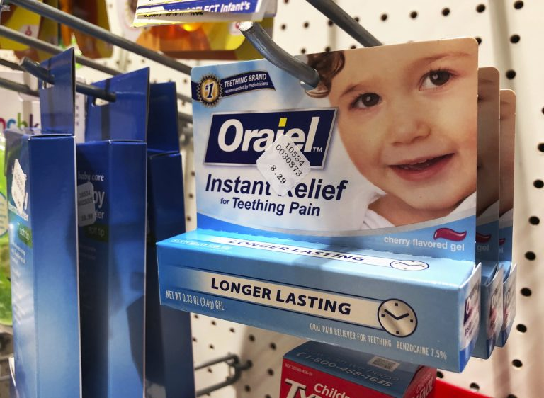 Orajel is displayed for sale in a pharmacy in New York Wednesday, May 23, 2018. The US Food and Drug Administration is warning parents about potentially deadly risks of teething remedies that contain a numbing ingredient used in popular brands like Orajel. The agency on Wednesday said it wants manufacturers to stop selling products intended for babies and toddlers because the products contain a drug ingredient that can cause a rare but dangerous blood condition that interferes with normal breathing. (Stephanie Nano/AP Photo)
