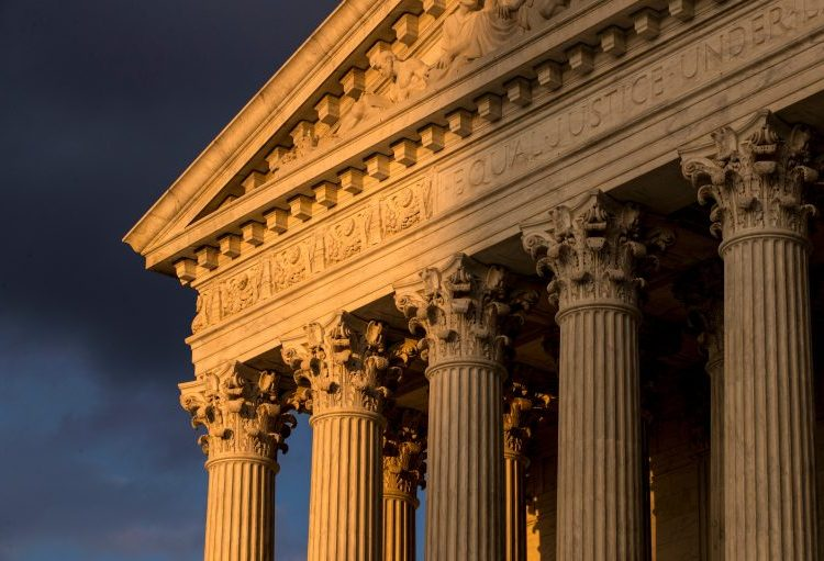 In this Oct. 10, 2017, file photo, the Supreme Court in Washington is seen at sunset. A flood of lawsuits over LGBT rights is making its way through the courts and will continue, no matter the outcome in the Supreme Court's highly anticipated decision in the case of a Colorado baker who would not create a wedding cake for a same-sex couple. (J. Scott Applewhite/AP Photo, File)