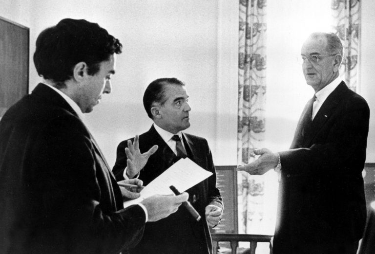 In this Jan. 12, 1966, photo provided by the White House, President Lyndon B. Johnson prepares for his State of the Union address with, (from left), Richard Goodwin, former presidential assistant called back from Wesleyan University to help on the speech, Jack Valenti and (not pictured) Joseph A. Califano, Jr. at the White House in Washington. Goodwin, an aide, speechwriter and liberal force for the Kennedys and Lyndon Johnson died Sunday, May 20, 2018, at his home in Concord, Mass. His wife, the historian Doris Kearns Goodwin, said he died after a brief bout with cancer. (The White House/AP Photo)