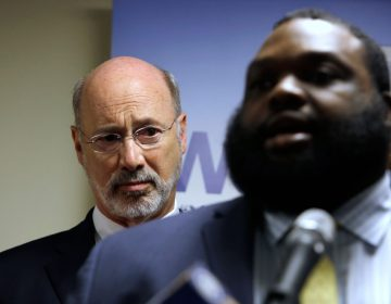 Pennsylvania Gov. Tom Wolf, left, listens to state Rep. Jordan Harris (D-Phila.) during a news conference Tuesday, May 8, 2018, in Philadelphia. Wolf announced a $1.5 million grant program aimed at reducing gun violence around the state. Wolf unveiled the Gun Violence Reduction Initiative Tuesday and Pennsylvania Commission on Crime and Delinquency is accepting applications for the grants and will start awarding them in early July. (Jacqueline Larma/AP Photo)