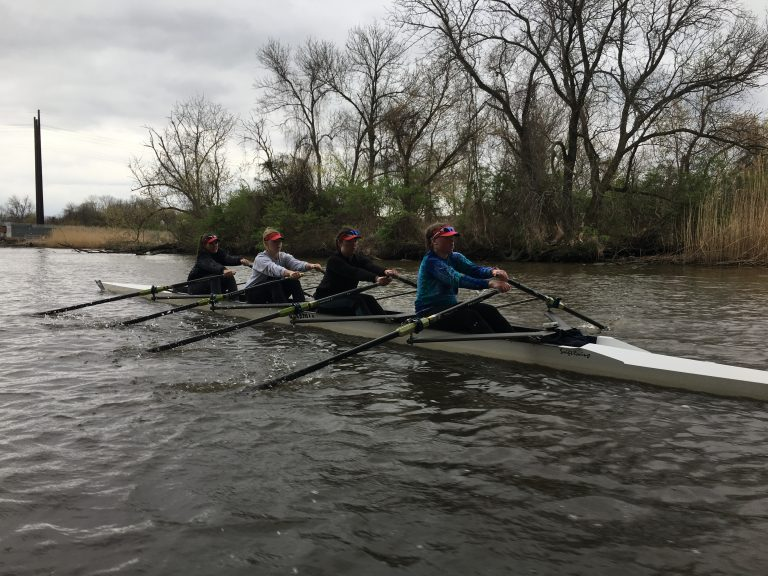 Members of the Newport Rowing Club make their way down the Christina River near Wilmington. (Mark Eichmann/WHYY)