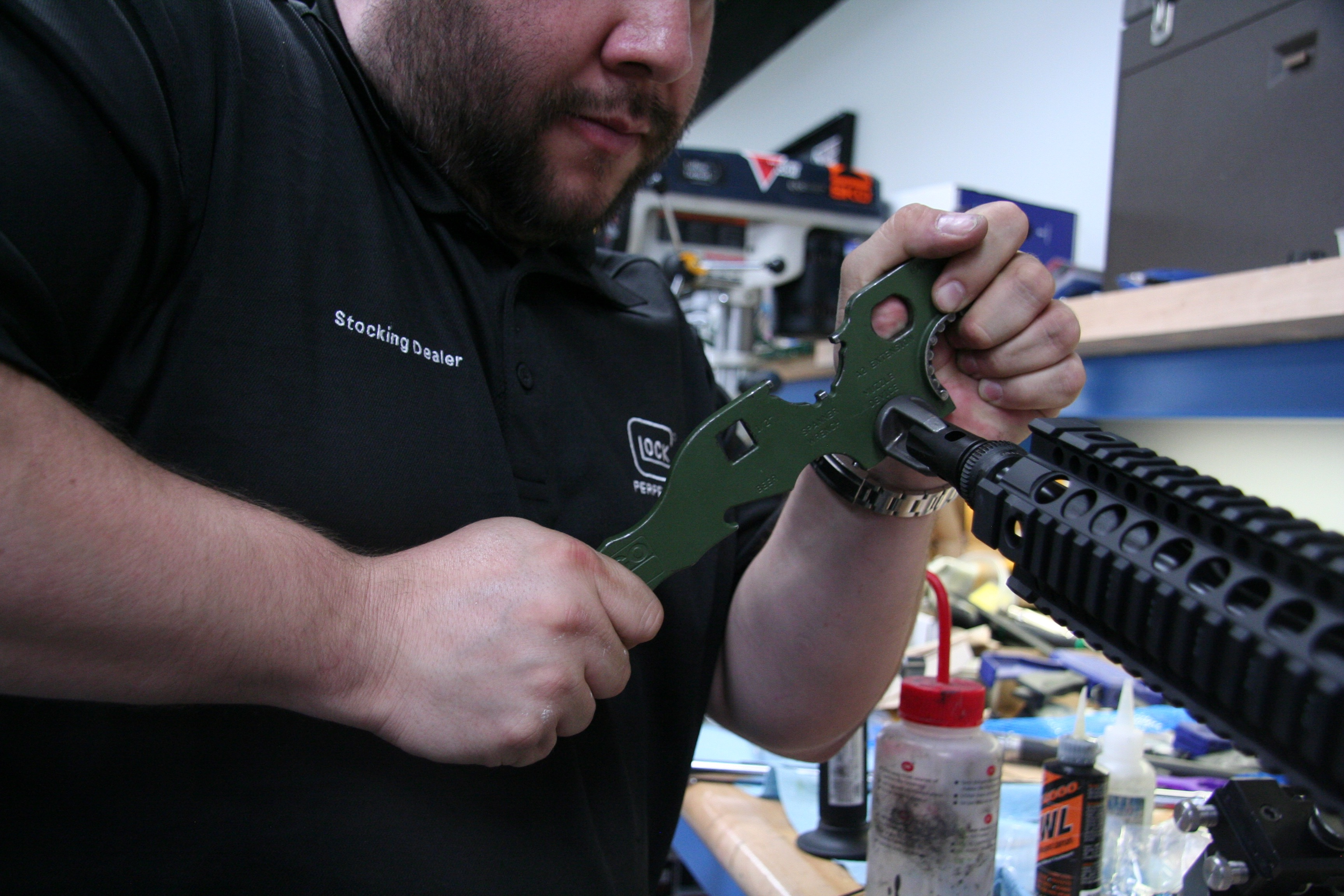 Engage Armament co owner Carlos Rabanales assemble a custom rifle. The shop had been known for customizing guns, but the smart gun flareup hurt the business.