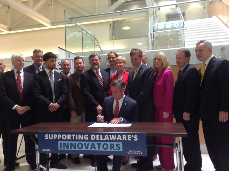 Gov. John Carney signs legislation that aims to incentivize startup businesses in Delaware. (Zoe Read/WHYY)