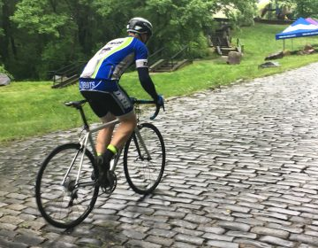 Injured Iraq war vet Brian Tibbits bikes his way up Monkey Hill in Wilmington in preparation for the Wilmington Grand Prix. (Mark Eichmann/WHYY)