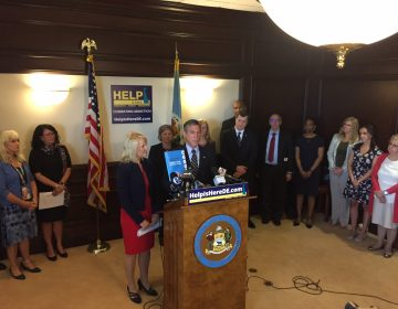 Delaware Gov. John Carney and Lt. Gov. Bethany Hall Long announce a three-year action plan to combat addiction and address mental health issues. (WHYY/Paul Parmalee)
