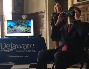Delaware Gov. John Carney takes a virtual tour of the state with the Delaware 360 video tourism officials are now using to promote the state. (Mark Eichmann/WHYY)