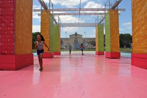 Children run through the mister at the Eakins Oval pop-up park.