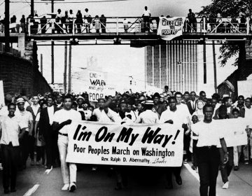 Sign-carrying participants march on the southern leg of the Poor People's Campaign May 10, 1968, in Atlanta. (AP file photo)