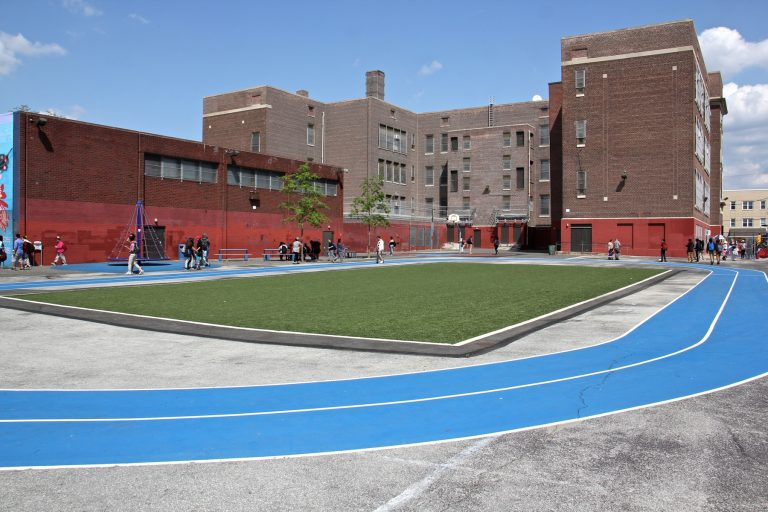 An astroturf field and track direct rainwater runoff toward a containment basin in the recently rebuilt Taggart School playground in South Philadelphia.