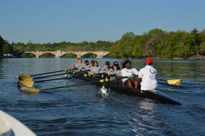 The Philly Council Dad Vail crew during practice on the Schuylkill Wednesday morning (Tom MacDonald/WHYY)