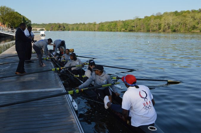 The Philly Council Dad Vail crew departs the dock during practice on the Schuylkill Wednesday morning (Tom MacDonald/WHYY)