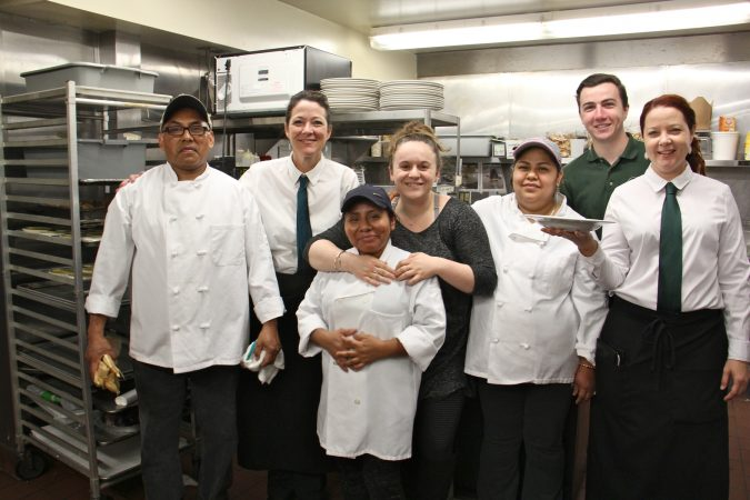 The staff of the Black Bass Hotel pose for a photo in the kitchen. (Emma Lee/WHYY)