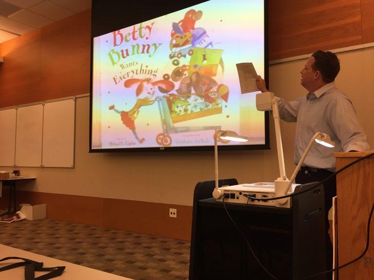 Todd Zartman gives his 'Kiddynomics' presentation.