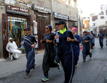 Saudi women jog in the streets of Jeddah in March. The government is encouraging greater participation by women in sports. (Amer Hilabi/AFP/Getty Images)